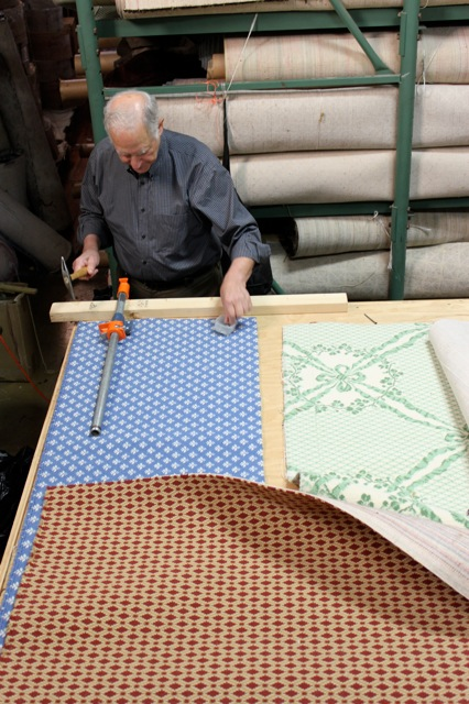 Image of Phil Pearlman working on carpets
